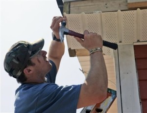 Brees helps rebuild a house after Hurricane Katrina. (AP Photo/Bill Haber)