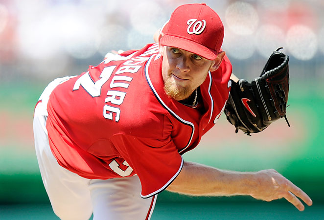 Stephen Strasburg will lead a refocused Nationals team on another playoff run in 2014. (Greg Fiume/Getty Images)