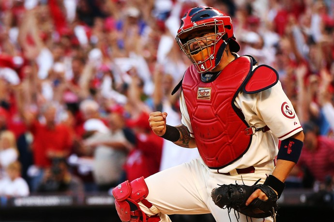 Yadier Molina has been the best defensive catcher in the MLB for some time now, and his offense has improved tremendously the past few years as well. (Photo by Elsa/Getty Images)